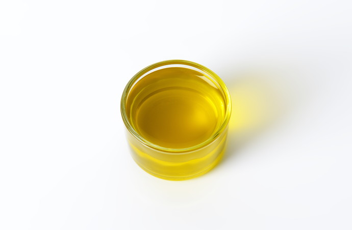 Glass of extra virgin olive oil