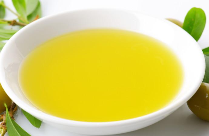 Olive oil in white porcelain bowl