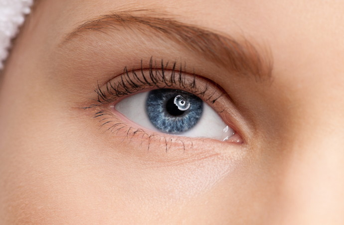 Close-up shoot of young beautiful girl with perfect skin: blue eye make-up zone. Macro