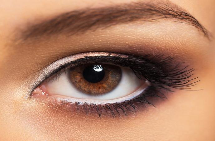 Closeup of beautiful womanish eye with glamorous makeup